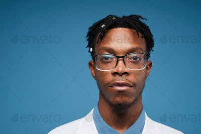 Young African-American Doctor on Blue