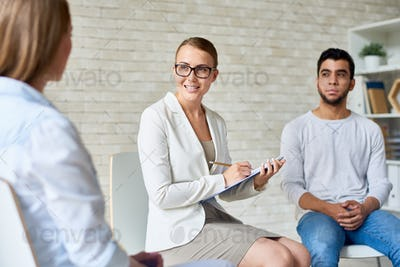 Beautiful Female Psychologist Leading Group Therapy Session