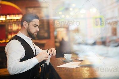 Handsome Businessman Working in Luxury Restaurant