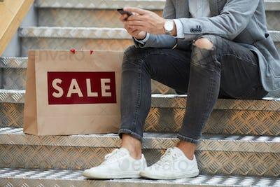 Man using Mobile App while Shopping