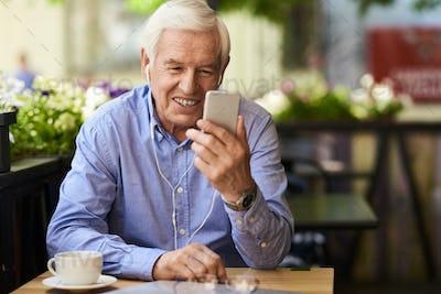 Modern Grandpa Using Video Call Technology