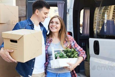 Joyful Young Couple Moving House