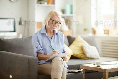 Senior Woman Calculating Finances