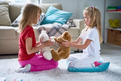 Little Girls Playing with Plush Toys