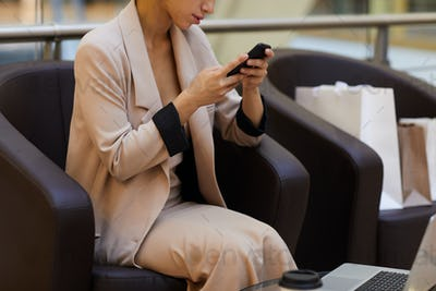 Businesswoman Relaxing in Shopping Mall