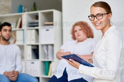 Professional Female Psychiatrist  Leading Group Therapy Session