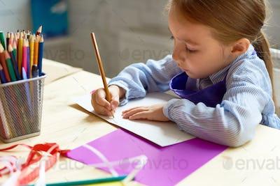 Cute Girl Drawing in Art Class