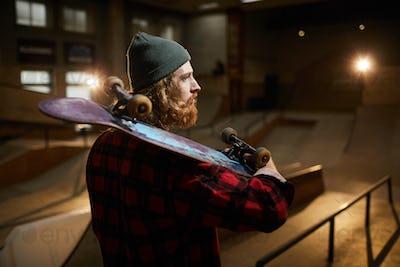 Bearded Man Holding Skateboard