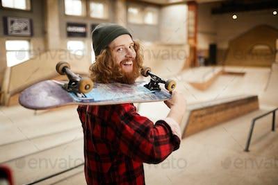 Bearded Skater Smiling at Camera