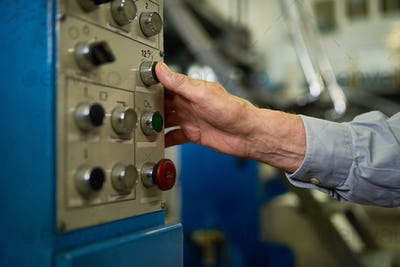 Senior Man Pushing  Buttons on Control Panel