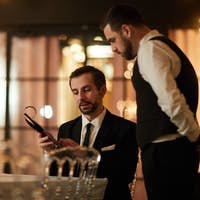 Mature Businessman Reading Menu in Restaurant