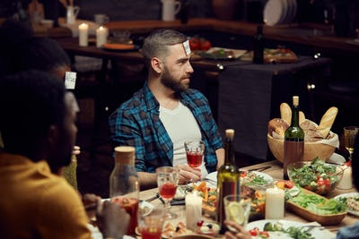 Man Playing Guessing Game at Party