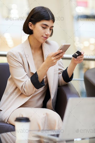 Beautiful Woman Buying Clothes Online