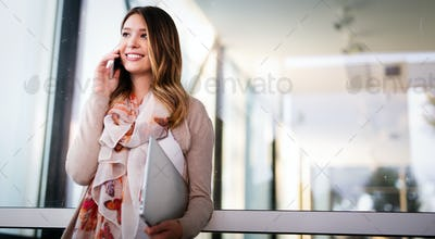 Business young woman speaking cellphone on the street