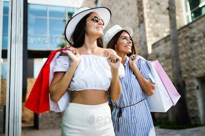 Happy friends shopping and traveling at summer