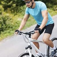 Man riding downward on his bike