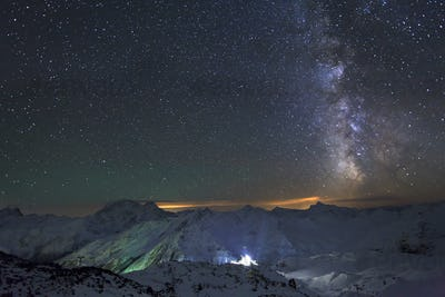 Milky Way and the moon over the Caucasus mountains