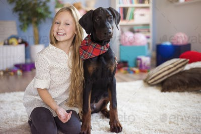 Blonde girl posing with her charming dog