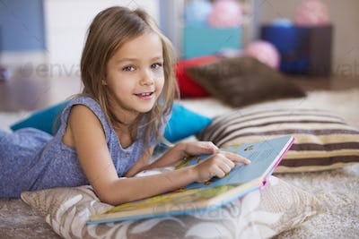 Girl reading in a very comfortable position