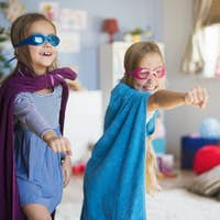 Female superheroes pretended by the little girls