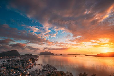 Alesund, Norway. Amazing Natural Bright Sunset Dramatic Sky In W