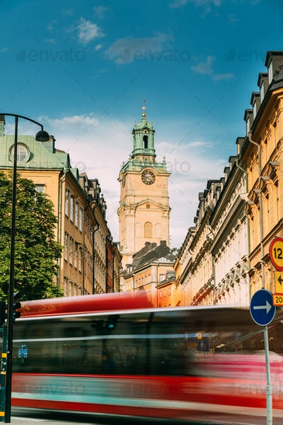 Stockholm, Sweden. Red Bus In Motion Blur Rides Near Old Town Wi
