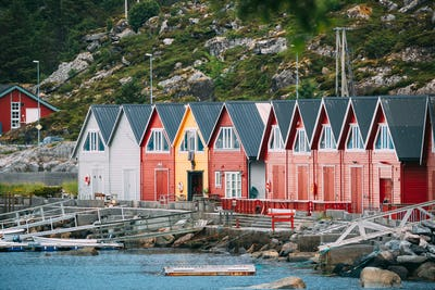 Alnes, Godoya, Norway. Red And Yellow Colorful Wooden Docks In S