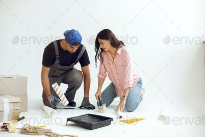 The young and cute family repairs the room