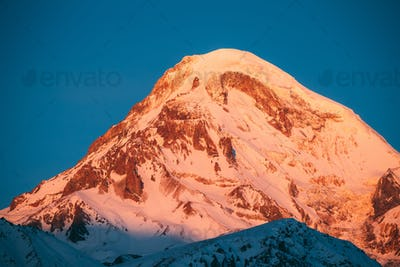 Georgia. Mount Kazbek Covered Snow In Winter Sunrise. Morning Da