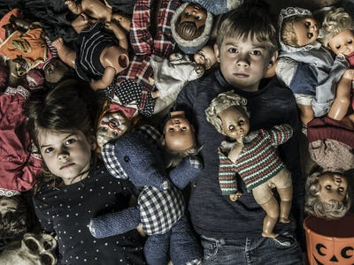 Creepy children with scary dolls