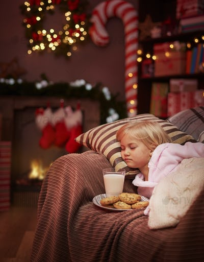 Cute girl tired of waiting for the santa claus
