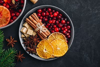 Mulled Wine Ingredients with cranberries, oranges, cinnamon