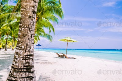 Tropical beach background at Panglao Bohol island with Beach chairs on the white sand beach with