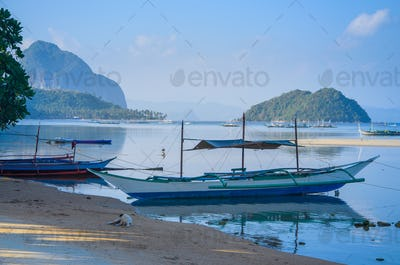 Traditional banca boat at sandy Corong Beach in El Nido, Philippines