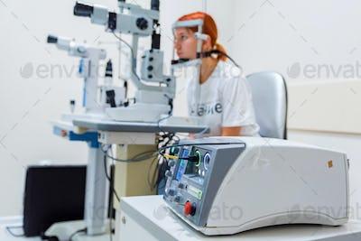 Teenage girl with red hair gets laser eye coagulation
