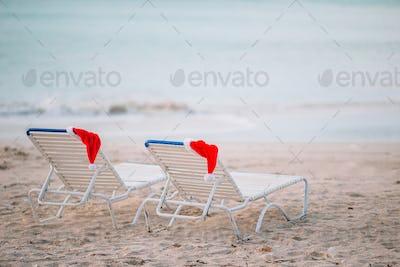 Closeup santa hat on chair on tropical white beach