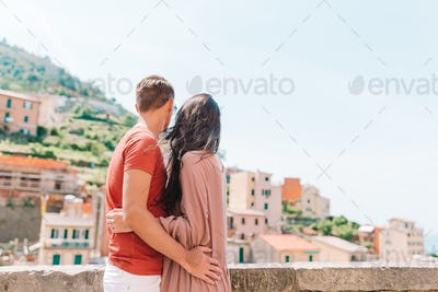 Tourists looking at scenic view of Riomaggiore, Cinque Terre, Liguria, Italy