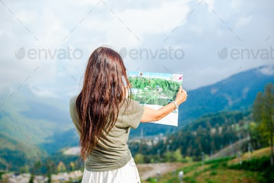 Happy young woman in mountains in the background of fog