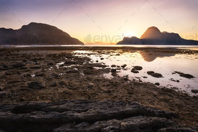 Sunset on El Nido village with silhouette of tropical islands in background. Palawan, Philippines