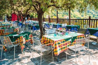 Summer empty outdoor cafe at tourist european city
