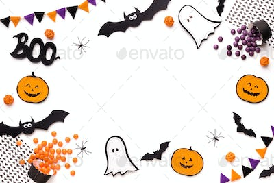 Flying ghosts, bats and pumpkins create round frame for text