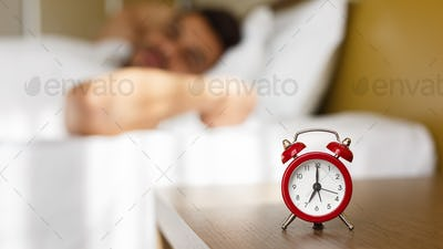 Arab man waking up in bed fully rested
