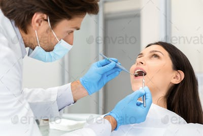 Young woman making check up in dental clinic