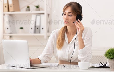 Lady In Headset Having Conversation With Customer In Call Center