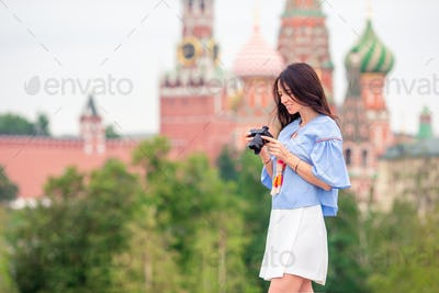 Professional photographer taking a city photo outdoors