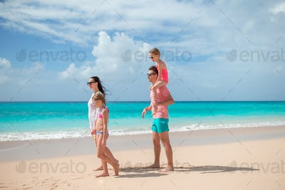 Happy family with kids on the beach together