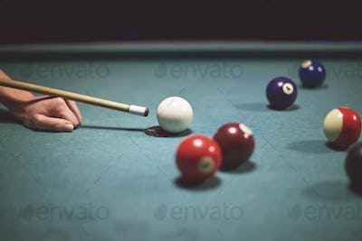 Professional player over the cue table