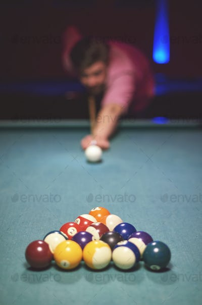 Man about to hit the cue ball