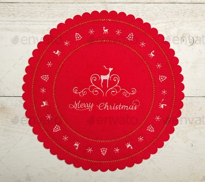 Christmas centerpiece or tablemat on white table.