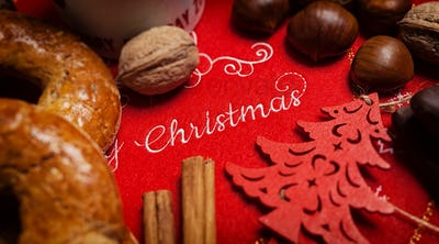 Merry Christmas text on a tablecloth with Christmas food